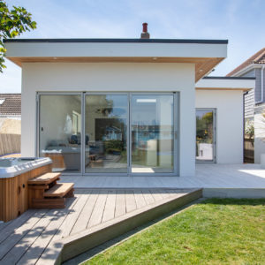 The bi-fold doors closed. The light grey frames match in with the seaside colour palette