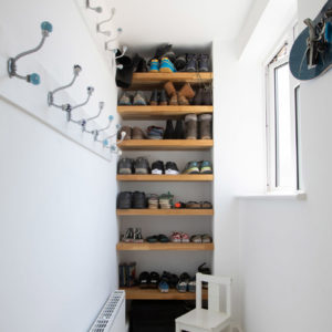 A clever design for this narrow boot room